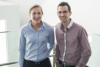 Two researchers standing smiling at camera
