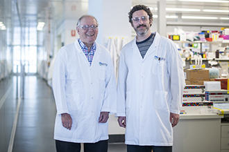 Two researchers standing in a laboratory