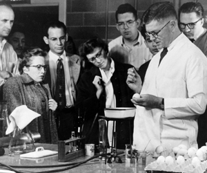 Burnet demonstrating in the laboratory