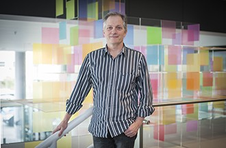 Associate Professor David Tarlinton standing in front of coloured boxes