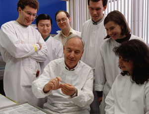 Don Metcalf in the lab with colleagues