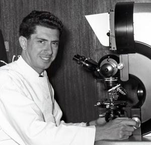 Professor Jacques Miller using a microscope