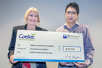 Jane Davies and Jason Tye-Din with a big cheque