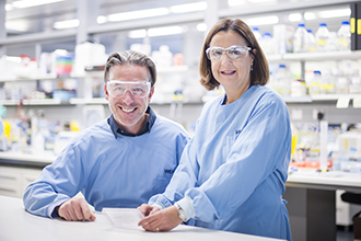 Dr Axel Kallies and Dr Diana Hansen pictured in lab, smiling at camera