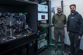 Researchers with instrument