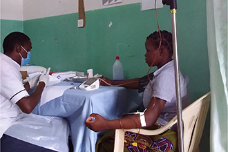 Woman with intravenous drip in a medical clinic