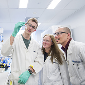Student and researchers in the lab