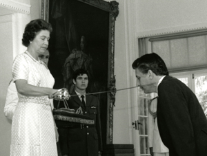 Queen Elizabeth II knighting Sir Gustav Nossal