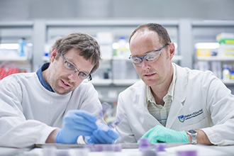 Scientists looking at sample in a lab