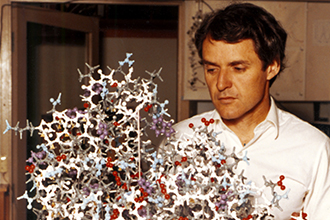 Professor Peter Colman with a protein structure