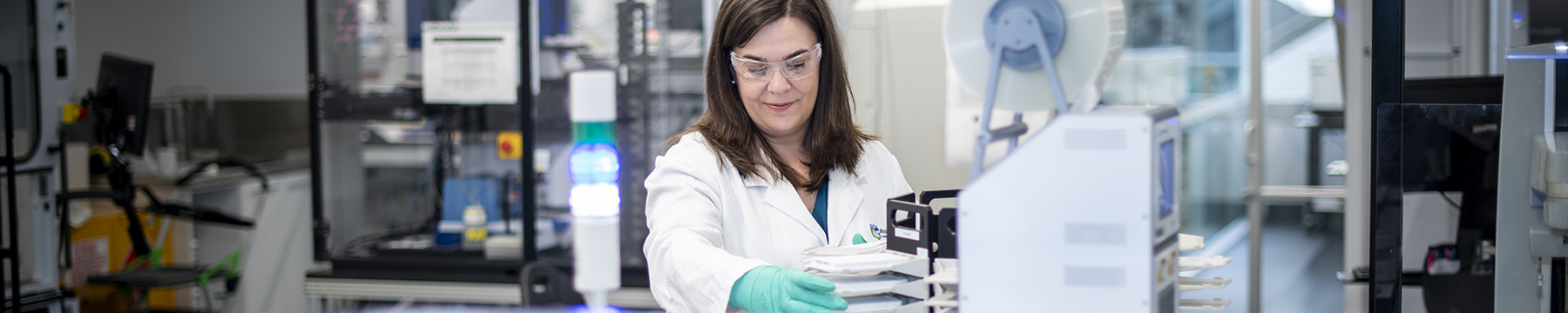 Scientist using screening technology