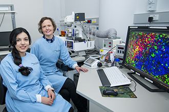Researchers with microscopy