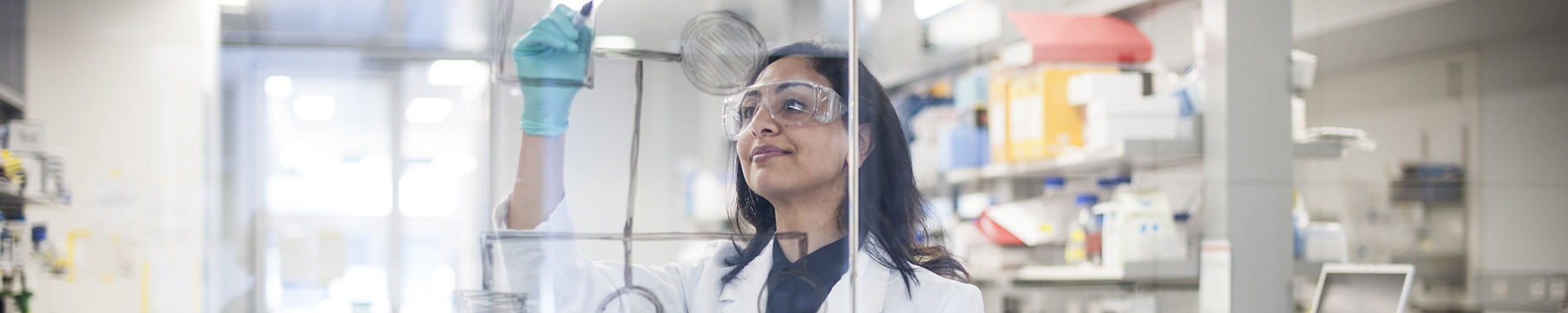Smiling researcher in the lab