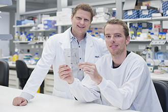 Dr Marc Pellegrini and Dr Greg Ebert in a laboratory