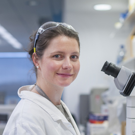 PhD student Helen McRae at microscope