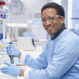 PhD student Sofonias Tessema at lab bench