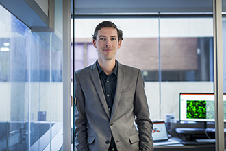 A/Prof Seth Masters standing in an office
