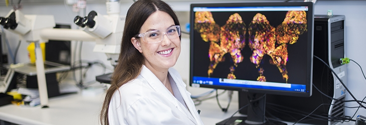Ms Clare Weeden with image of lung stem cell on computer