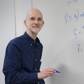 Professor Gordon Smyth writing on a whiteboard