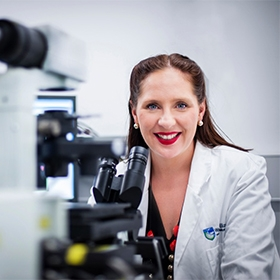 Dr Misty Jenkins at a microscope
