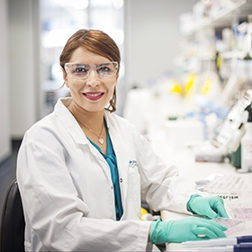 Dr Maryam Rashidi at a laboratory bech