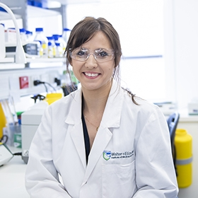 Dr Rebecca Feltham photographed in a laboratory
