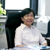 Professor Li Wu in an office