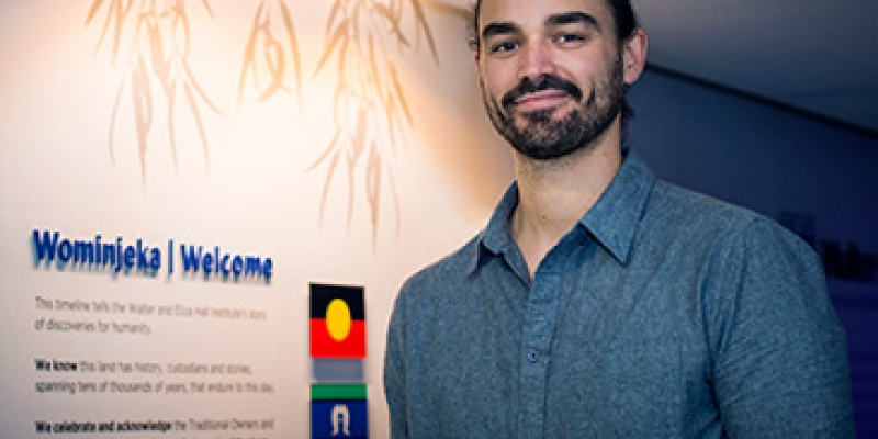 Dr Jason Brouwer at the Institute's Wominjeka wall