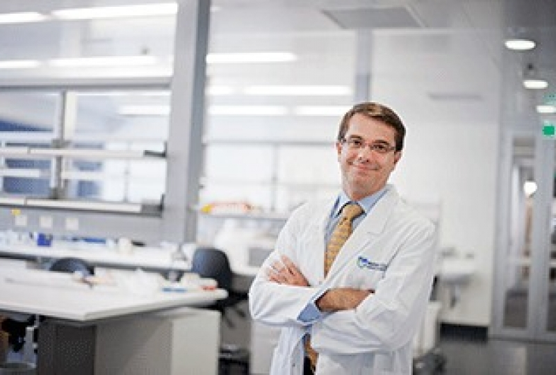 Professor Andrew Roberts standing in a lab