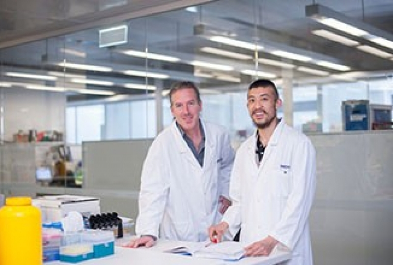 Dr Axel Kallies and Mr Kevin Man standing in a lab