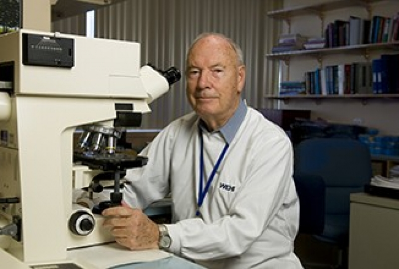 Professor Don Metcalf in front of a microscope