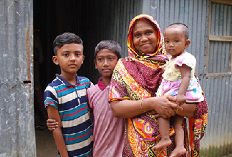 Smiling mother and children