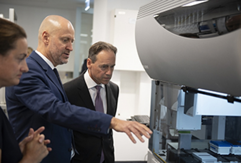 Greg Hunt is shown robotic equipment by the Institute director