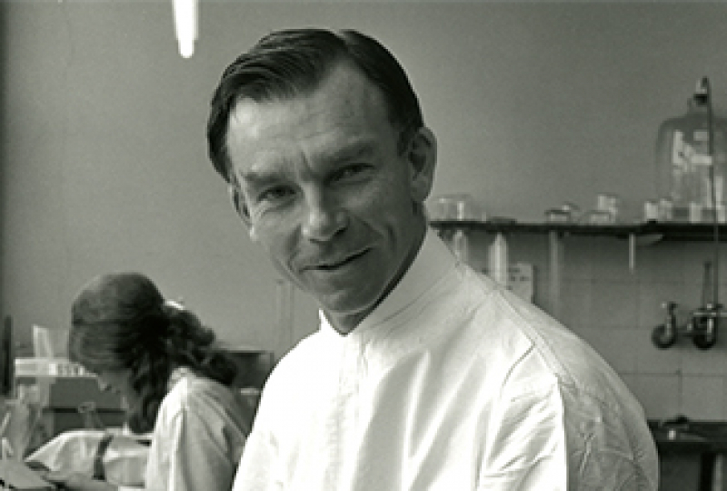 Black and white historic picture of smiling researcher