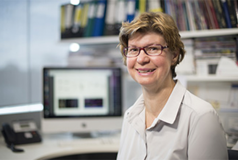 Researcher smiling at camera
