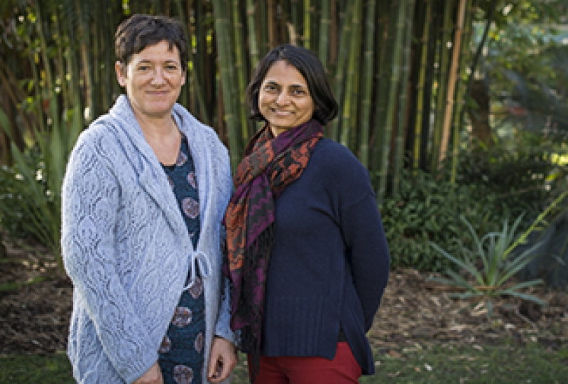 Isabelle Lucet and Onisha Patel standing in a garden, smiling at camera