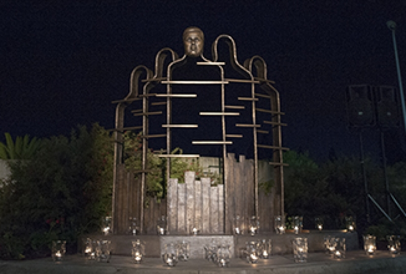 Mathison sculpture at night with candlelight