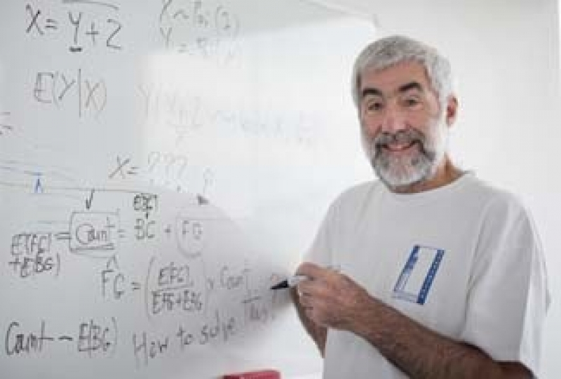 Professor Terry Speed drawing on a whiteboard