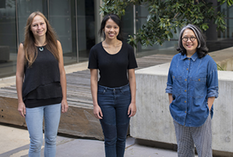 Three female researchers standing outside WEHI