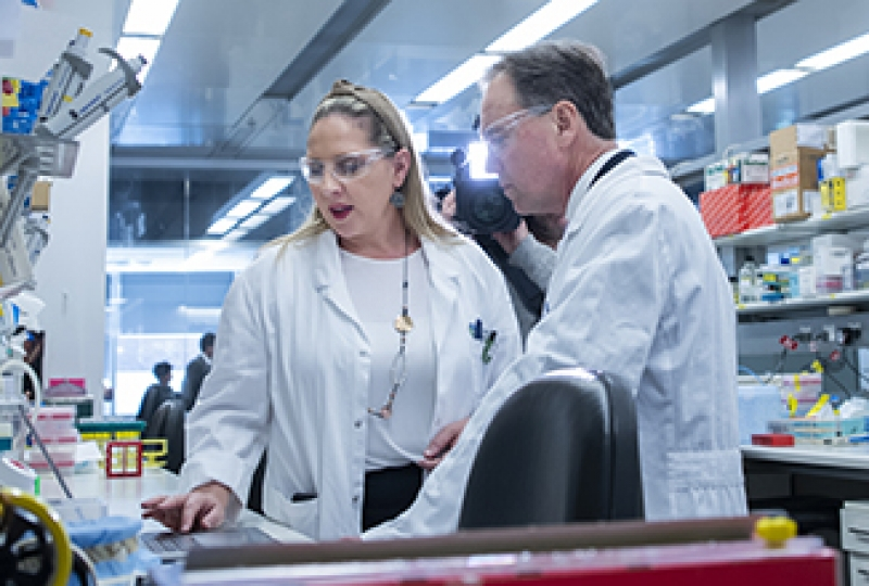 Dr Misty Jenkins with Health Minister Greg Hunt in a laboratory