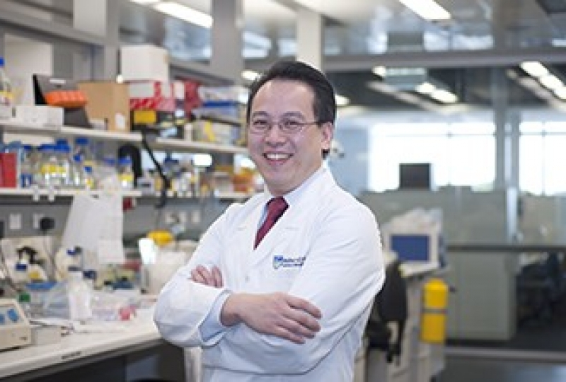 Dr Ashley Nga standing in lab