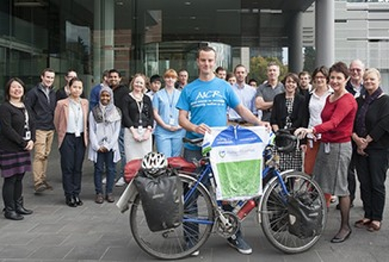 Cyclist Chris Gruar with bicycle in front of institute