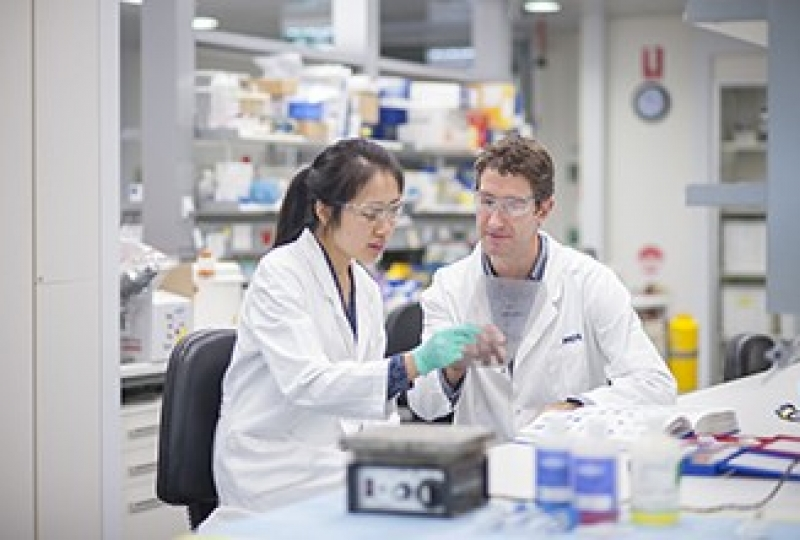 Ms Grace Liu and Dr Ross Dickens in a lab