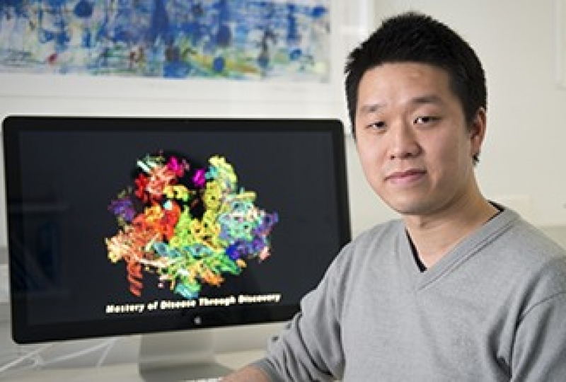 Dr Wilson Wong in front of computer