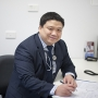 Dr Ben Tran in a consulting office