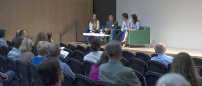 Researchers speaking to the audience at a public forum