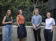 Four researchers standing in the WEHI garden