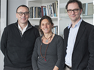 Trustees with researcher in an office
