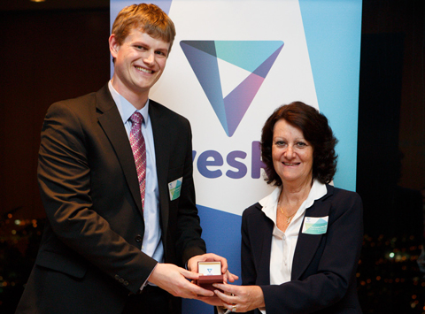 Dr Ethan Goddard-Borger recieves a 2013 veski fellowship by the Victorian Minister for Innovation Ms Louise Asher