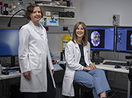 Two scientists with imaging equipment
